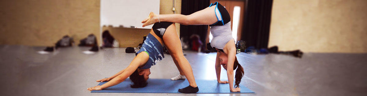 Students stretching in pairs