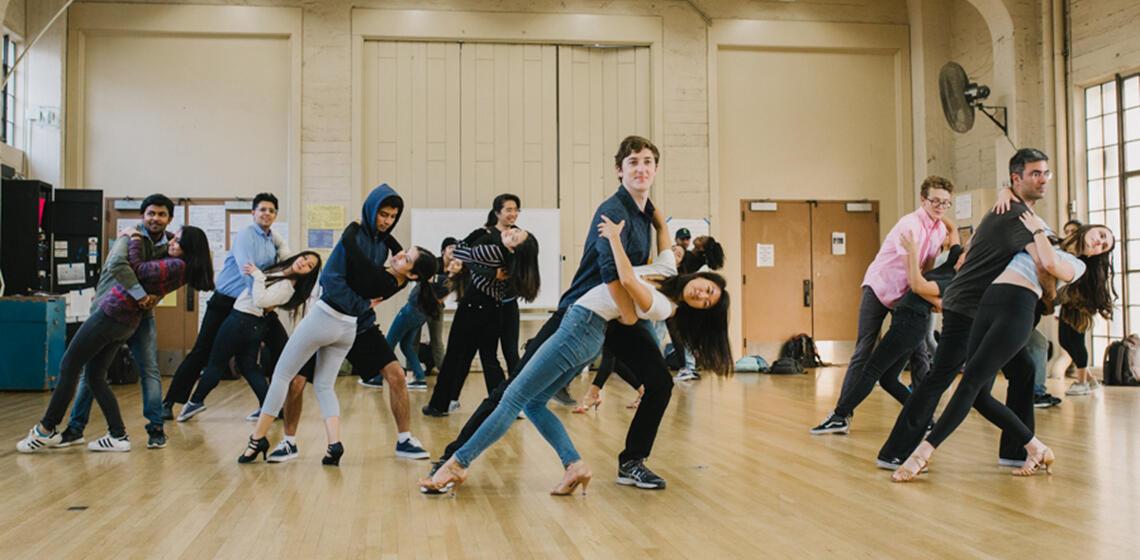 Students partner dancing