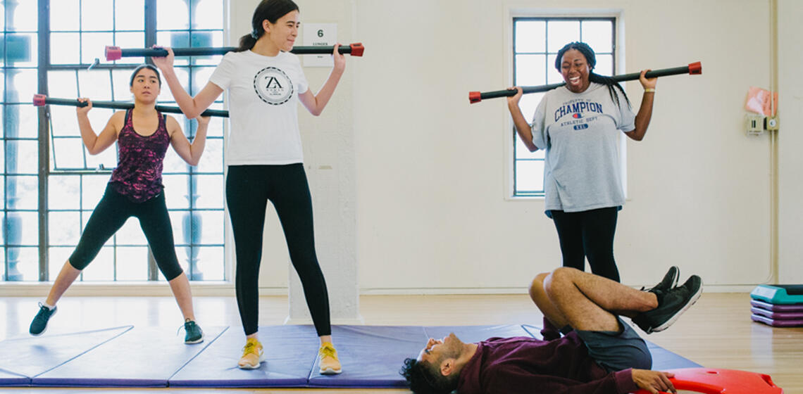 Students laughing during a fitness class