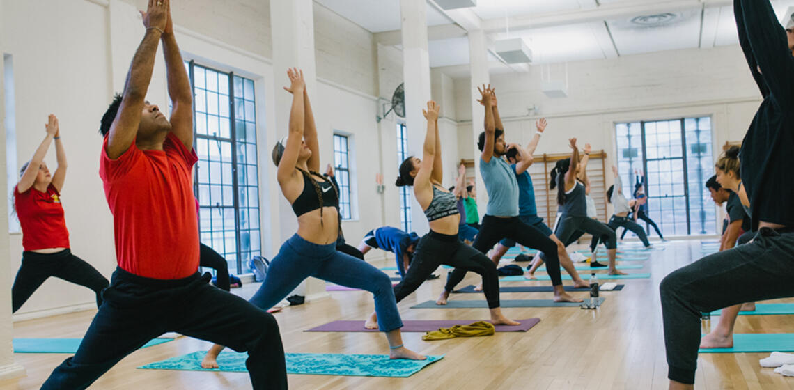 Students performing yoga poses